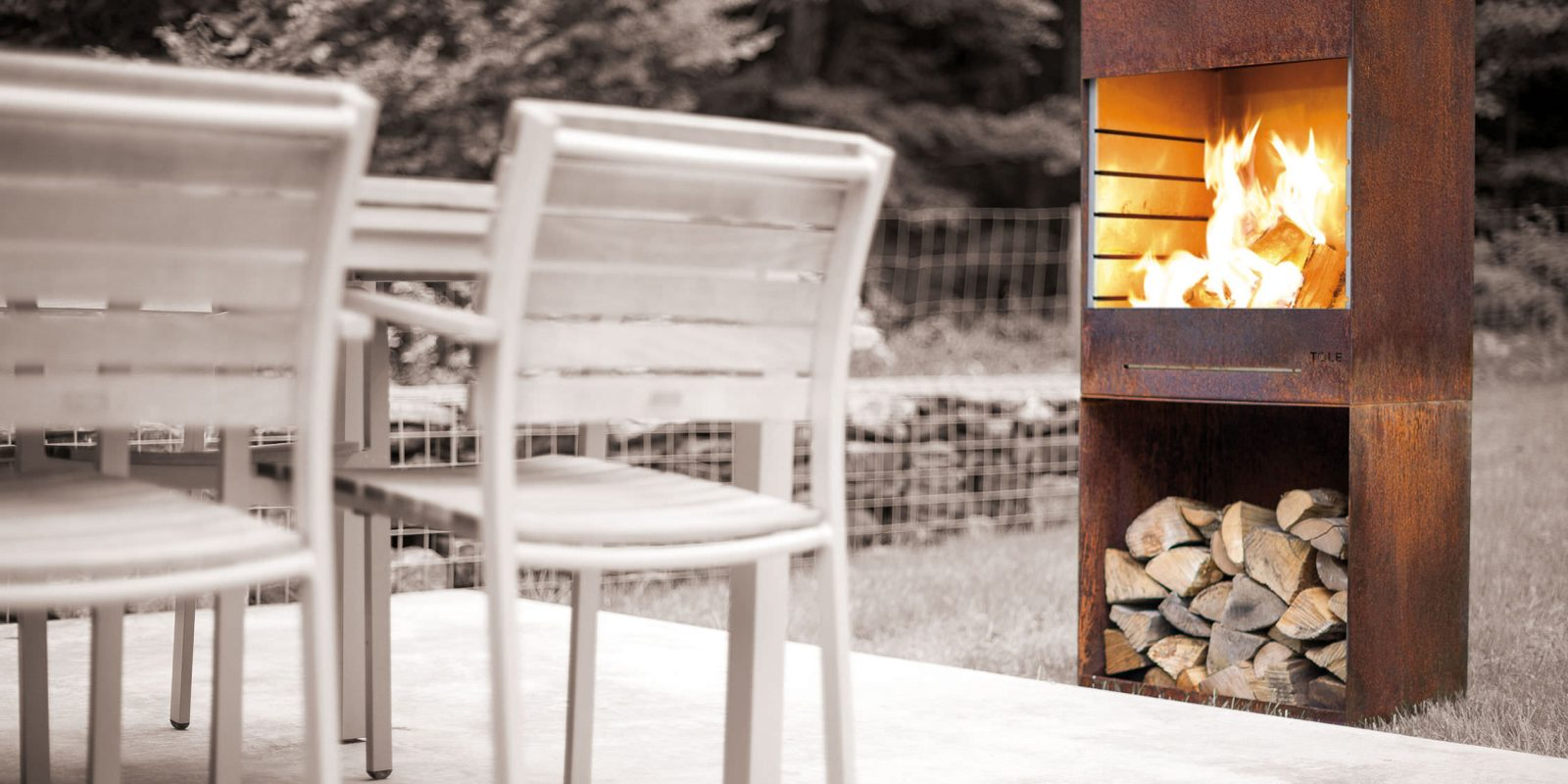 Tole's sleek outdoor fireplace also cooks pizza, grills and more
