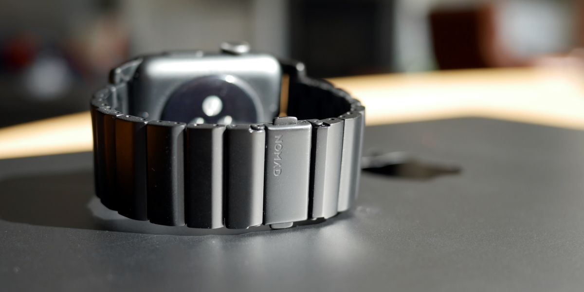 Nomad Titanium Apple Watch Band shown with MacBook Pro