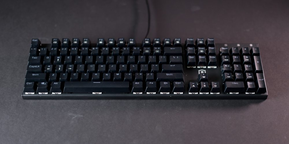 Plugable Red Switch Keyboard on table