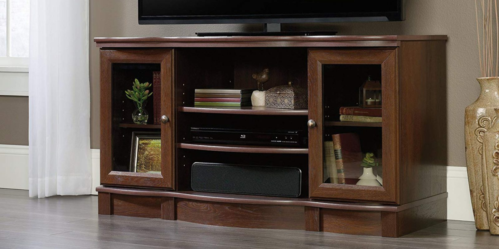 Declutter the living room with Sauder's Regent Place TV Stand: $129 (Save 20%)