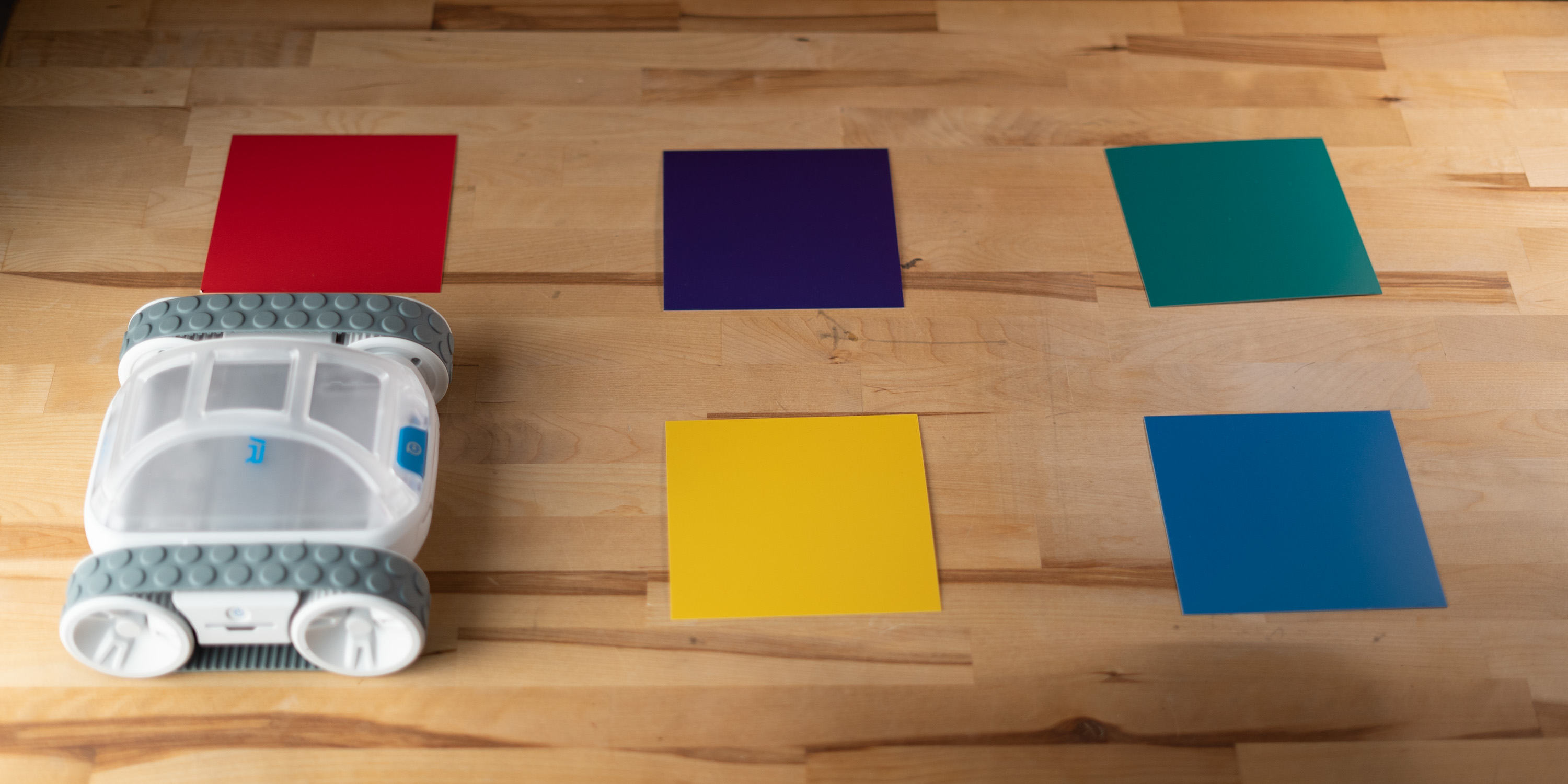 Sphero RVR lined up in front of color squares