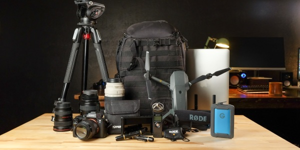Camera backpack with equipment on table
