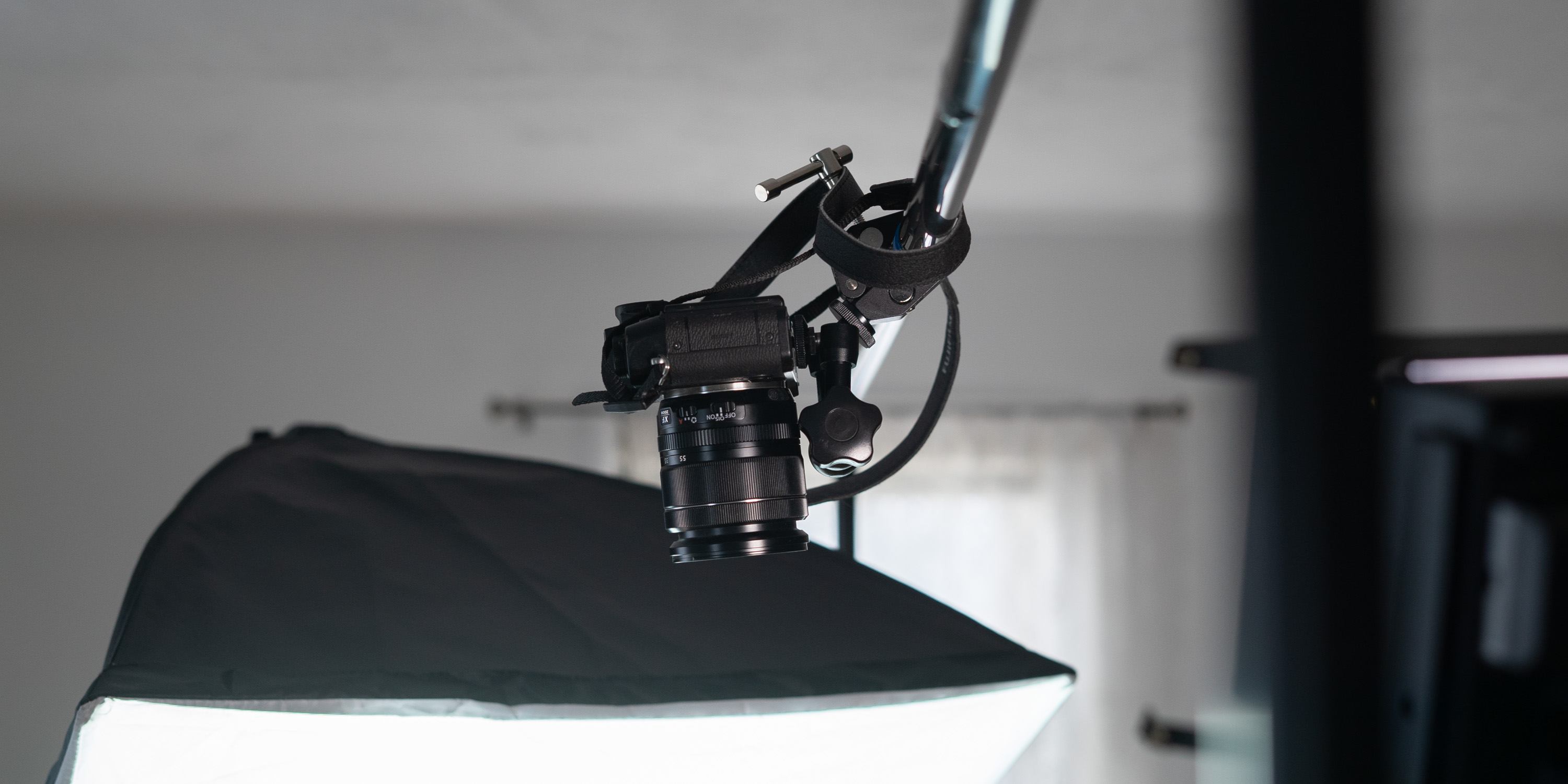 Camera mounted overhead on backdrop stand
