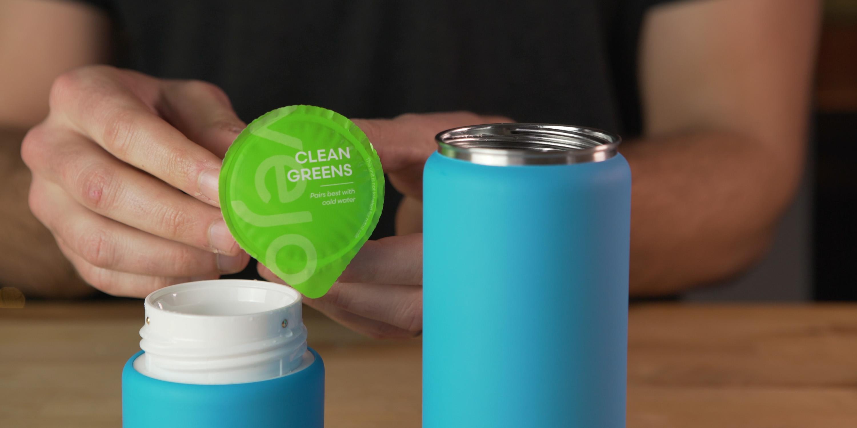 Putting clean green pod in Vejo Blender