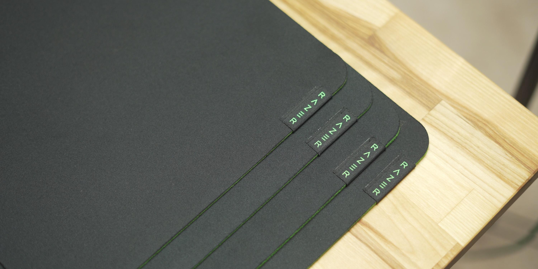 Razer Gigantus V2 tags lined up on desk
