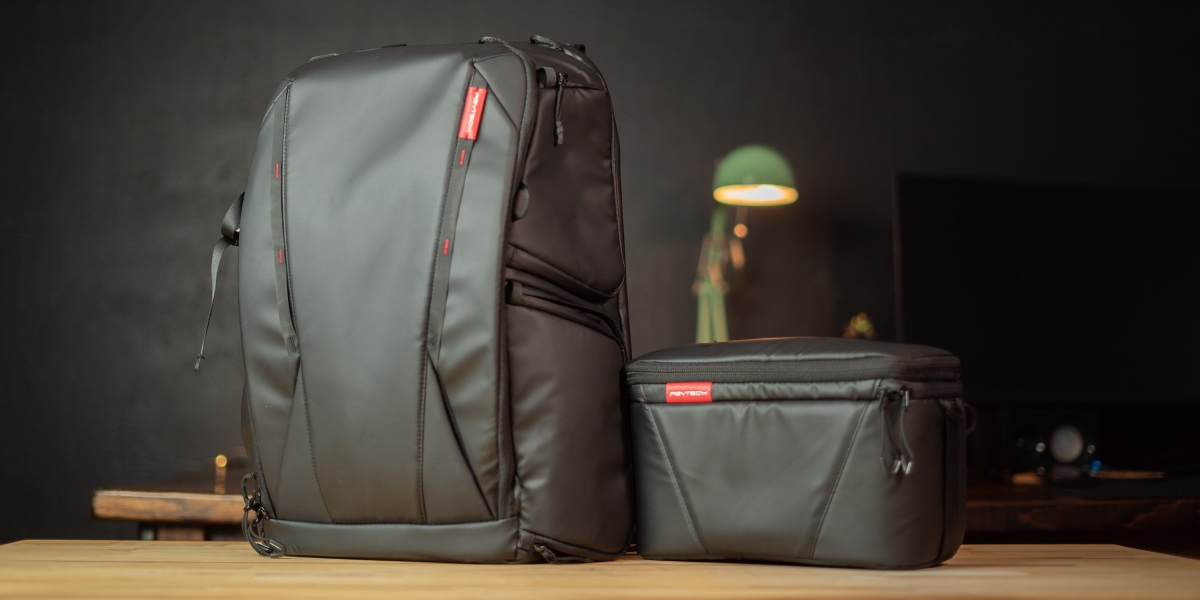 OneMo backpack and shoulder bag on table