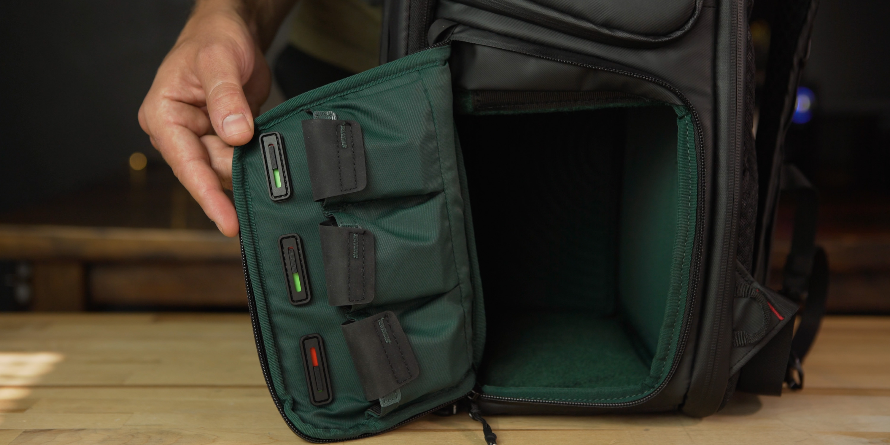 Dedicated battery pouches with charge indicators on the OneMo camera bag