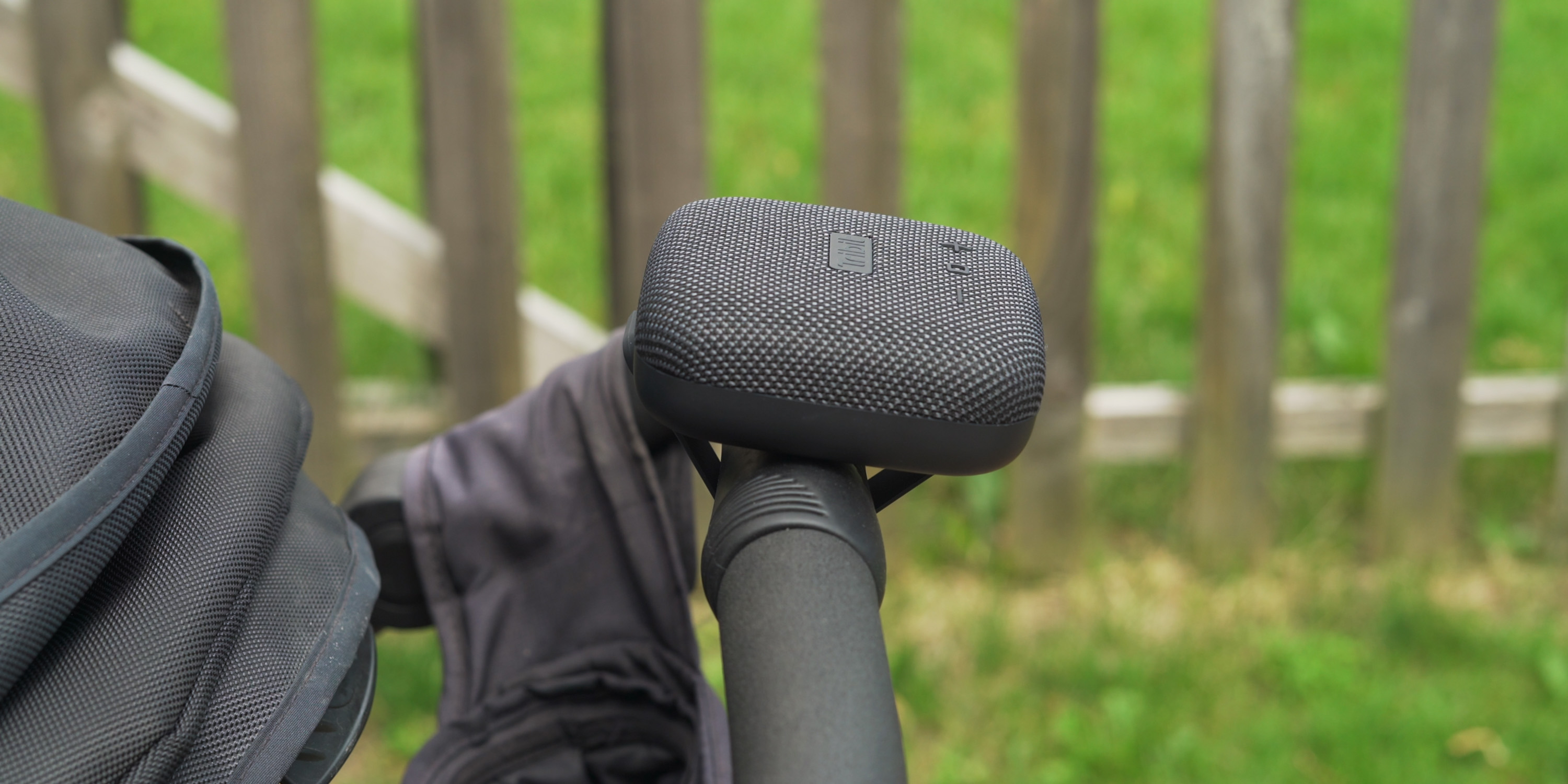 Tribit StormBox Micro attached to stroller handlebar