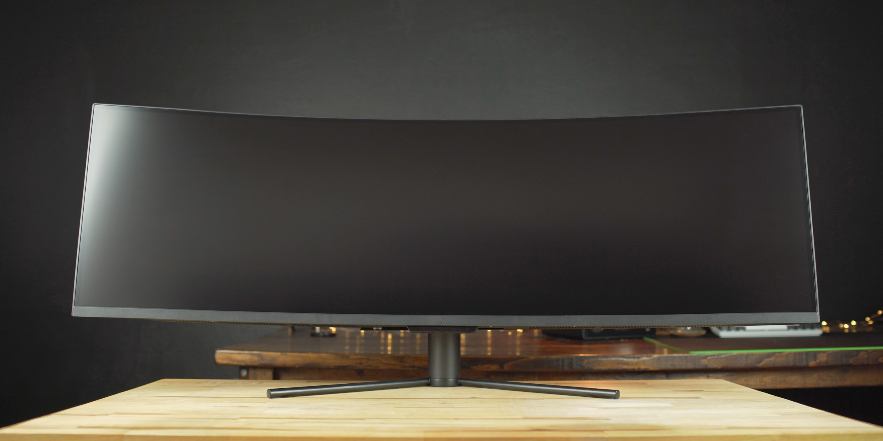 Dark Matter 49-inch monitor standing on a desk