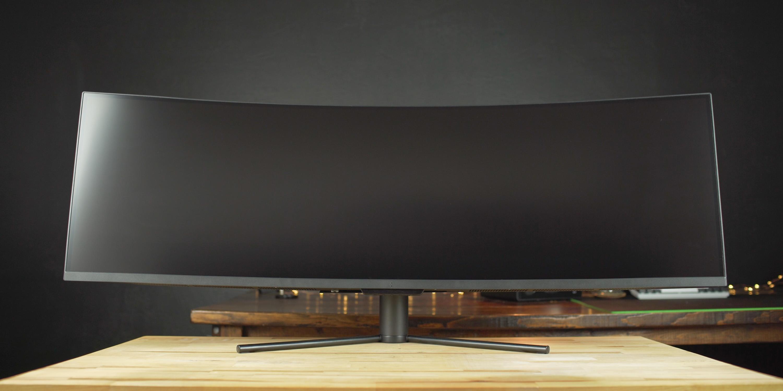 Dark Matter 49-inch monitor standing on a desk
