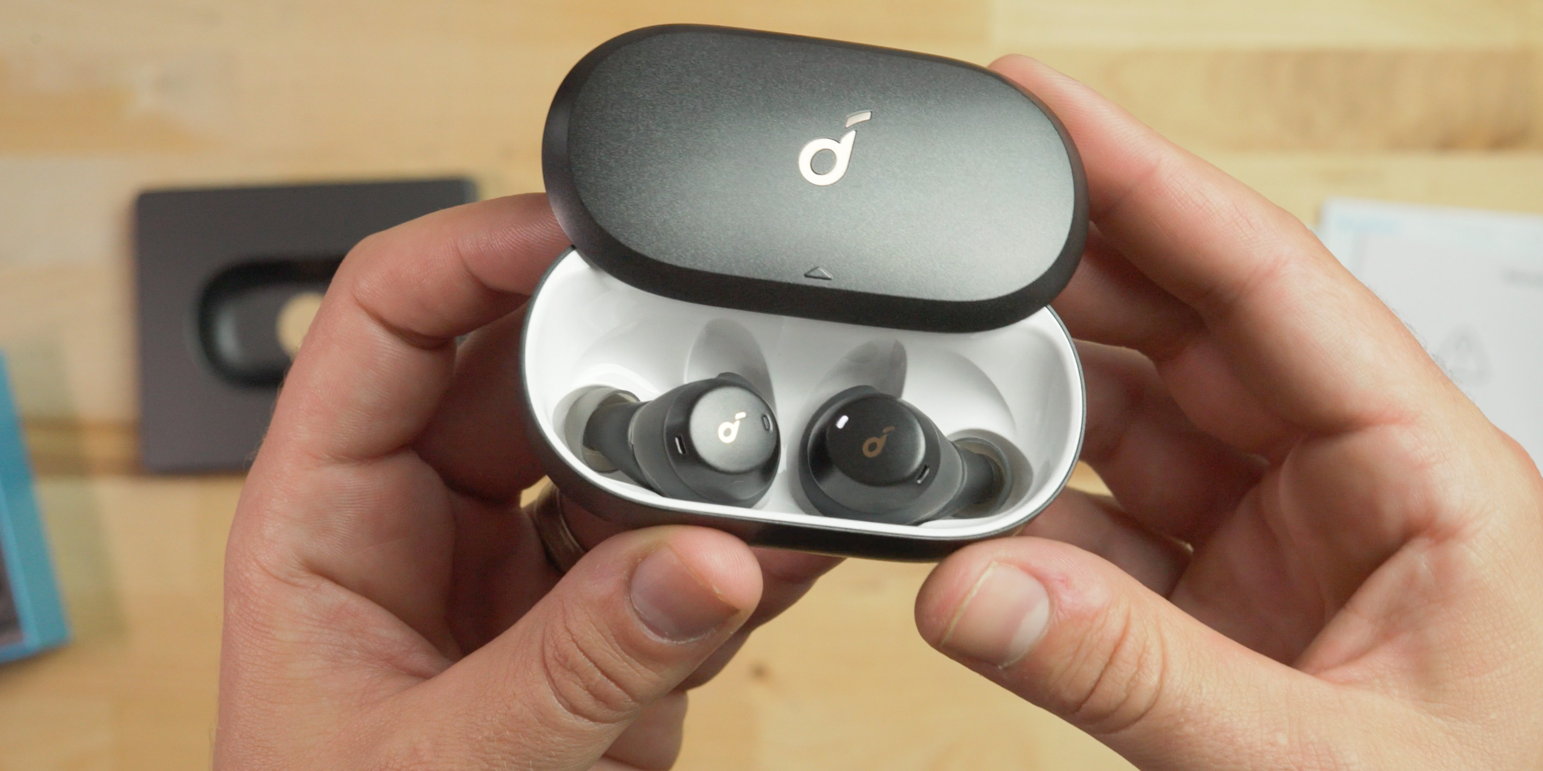 Holding the charging case of the Soundcore Spirit Dot 2