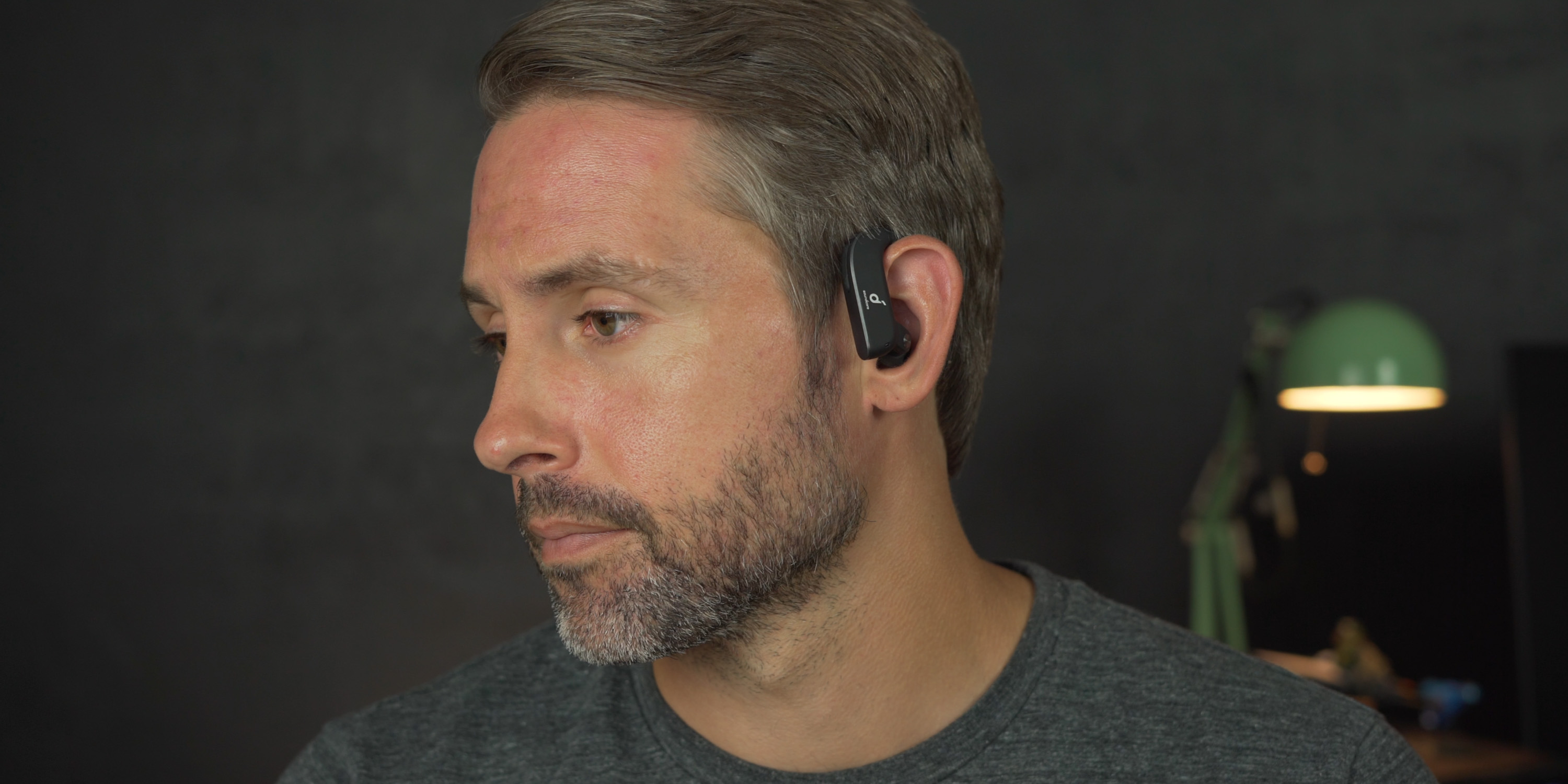 Wearing the Soundcore Spirit X2 earbuds