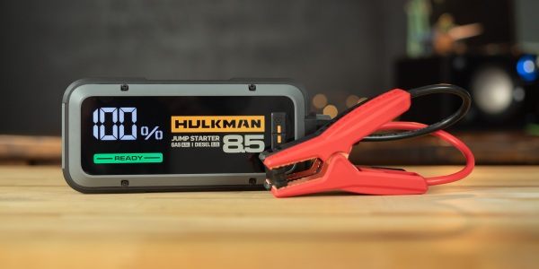 Hulkman Alpha 85S on desk with charging cables