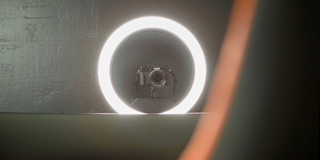 Elgato Ring Light hovering over a monitor in a streaming setup
