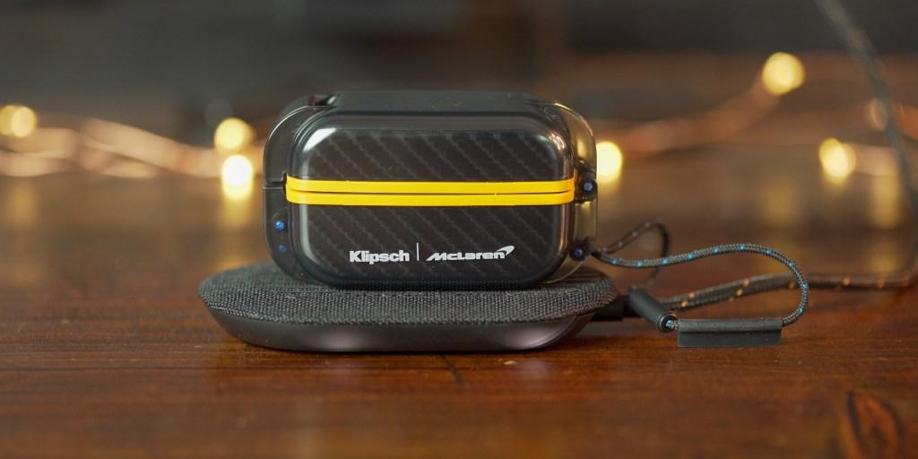 Klipsch T5 II Sport Mclaren sitting on the wireless charging pad.