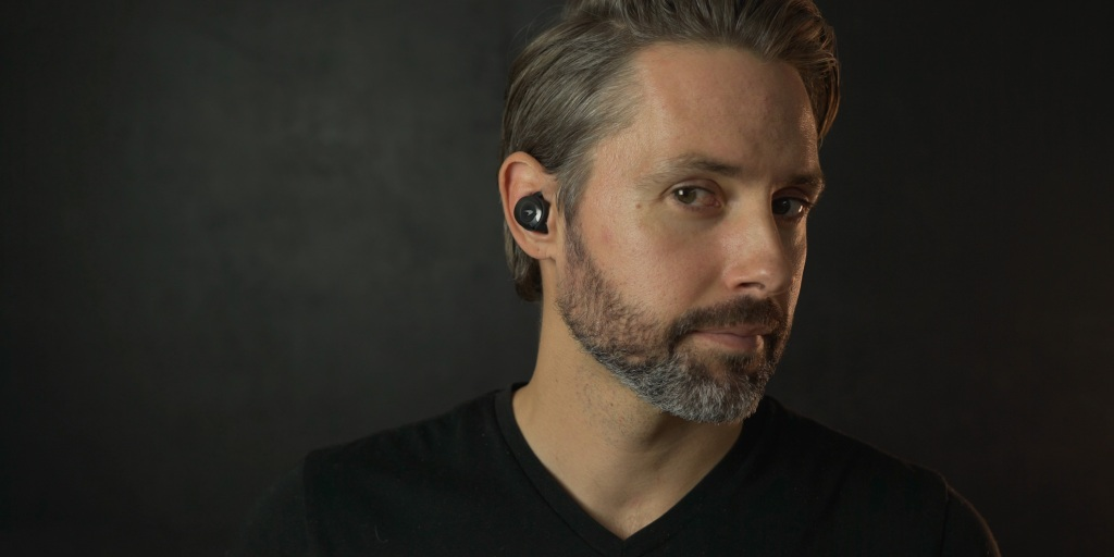 wearing the Klipsch T5 II Sport Mclaren earbuds.