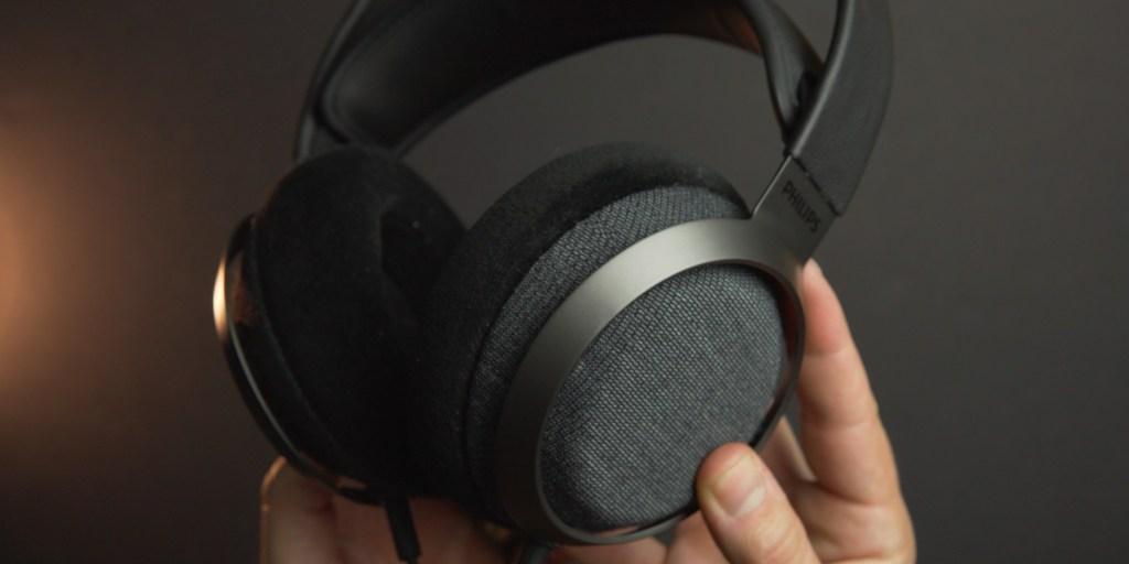 Holding the X3 headphones
