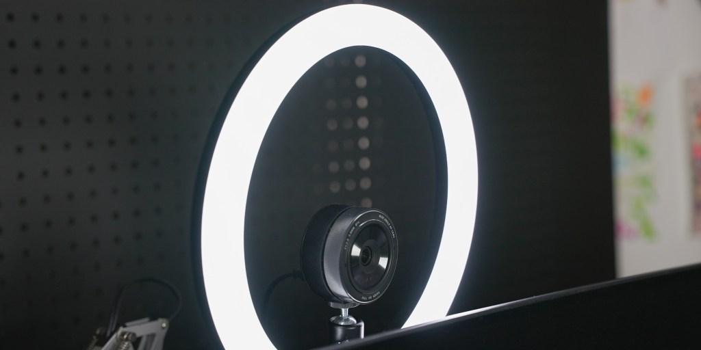 Razer Kiyo mounted in ring light behind computer monitor.