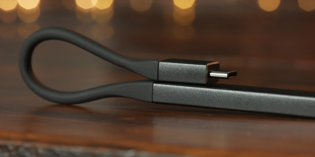 The THX Onyx can clip to itself to help manage cables when on the go.