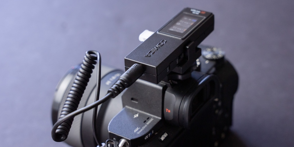Comica VDLive10 set up on a mirrorless camera.
